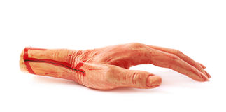 Fake severed hand isolated royalty free stock photography
