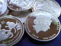 Fake silver coins. Pile of  false 1 ounce silver coins sold in web shops Royalty Free Stock Image