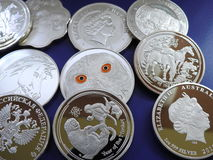Fake silver coins. Pile of  false 1 ounce silver coins sold in web shops Stock Photo
