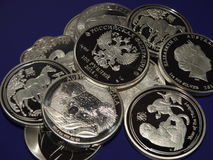 Fake silver coins. Pile of  false 1 ounce silver coins sold in web shops Royalty Free Stock Photography