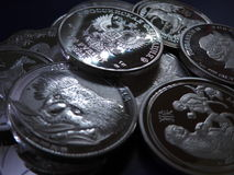 Fake silver coins. Pile of  false 1 ounce silver coins sold in web shops Stock Photography