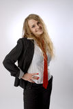 Fake smile. Business women makes fake smile. She wears black jacket, white short and red tie royalty free stock photos