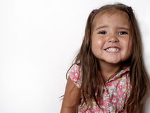 Fake Smile. Young girl with a fake forced smile for the camera Royalty Free Stock Photography