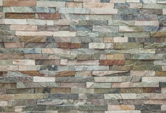 Fake stone wall brick background wallpaper Stock Photography