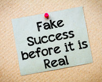 Fake success before it is real. Message. Recycled paper note pinned on cork board. Concept Image Stock Photos