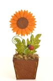 Fake sunflower. In pot made from sponge stock images