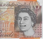Fake ten pound note currency money. Photo of a british fake ten pound note with the queen looking rather bemused by it all royalty free stock photography