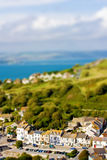 Fake toy village view over hills and sea Royalty Free Stock Photos
