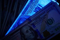 Fake us dollar bill in UV light. Closeup Stock Image