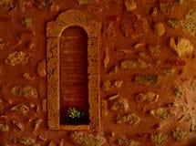 Fake window. In an orange stone wall Stock Photography