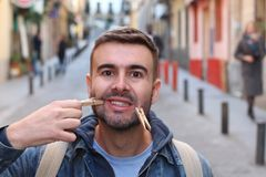 Faking a smile with clothes pins.  stock photography