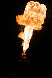 Fakir breathes spurts of fire. In the dark royalty free stock photos