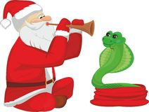 Fakir Santa Claus and snake. Santa Claus plaing on pipe and snake Royalty Free Stock Photo