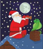Fakir Santa Claus and snake. Santa Claus playing on a pipe, and a snake on a house roof in Christmas night Royalty Free Stock Photos