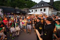 Faklcug - Traditional night march with torches in Spania Dolina, Slovakia. SPANIA DOLINA, SLOVAKIA - AUG 6, 2017: Faklcug - Traditional night march with torches royalty free stock photo