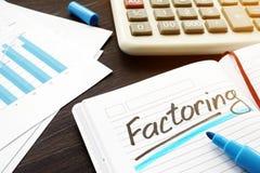 Faktors Darstellen Faktors Darstellen geschrieben in eine Anmerkung und in Dokumente lizenzfreie stockfotografie
