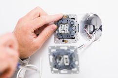 Faktotum Installing Socket Arkivfoto