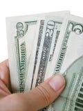 fakturerar dollarhandholdingen Royaltyfri Bild