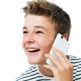 Fala adolescente considerável no telefone esperto Imagens de Stock Royalty Free