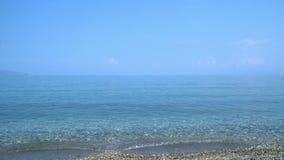 fala na otoczak plaży zdjęcie wideo