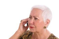 Fala sênior preocupada da mulher Fotografia de Stock Royalty Free