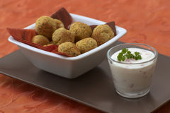 Falafel. Bowl with falafel which are vegetarian and made from chickpeas together with some yoghurt dip Royalty Free Stock Photo