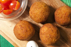 Falafel balls on a board royalty free stock images