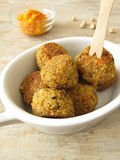 Falafel balls with carrots dip Royalty Free Stock Photos