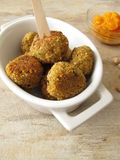 Falafel balls with carrots dip Royalty Free Stock Images