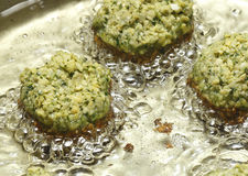 Falafel balls frying in oil Royalty Free Stock Photos