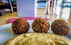 Falafel balls with hummus in a takeaway royalty free stock photography