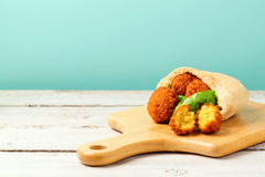 Falafel balls served with pita and lettuce on a wooden board Royalty Free Stock Photo