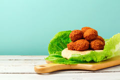 Falafel balls served with pita on a wooden board Stock Images