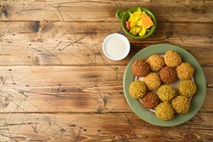Falafel balls with tahini sauce on wooden board royalty free stock images