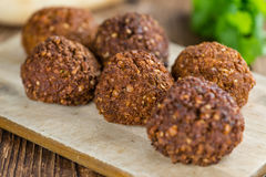 Falafel. (close-up shot; selective focus) on an old wooden table Stock Image