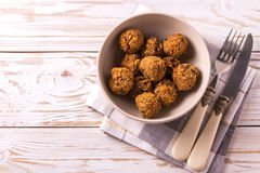Falafel with cutlery and napkin. Jewish Cuisine. Top view. Traditional homemade falafel served with cutlery and napkin on wooden table. Jewish Cuisine. Top view Royalty Free Stock Photos