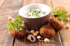 Falafel and dip. On wood Stock Images