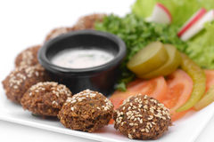 Falafel dish with veggies closeup. Isolated on white Royalty Free Stock Images