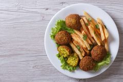 Falafel with French fries, lettuce top view horizontal Stock Image