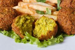 Falafel with French fries, lettuce on a white plate macro Stock Photo