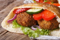 Falafel with fresh vegetables in pita bread close-up Royalty Free Stock Images