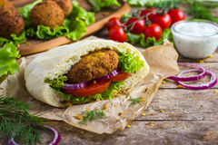 Falafel with fresh vegetables in pita bread royalty free stock image