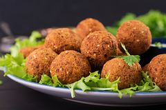 Falafel, hummus and pita. Middle eastern or arabic dishes on a dark background. Halal food stock image