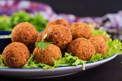 Falafel, hummus and pita. Middle eastern or arabic dishes on a dark background. Halal food royalty free stock image