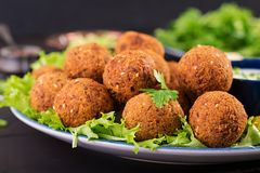 Falafel, hummus and pita. Middle eastern or arabic dishes on a dark background. Halal food stock photos