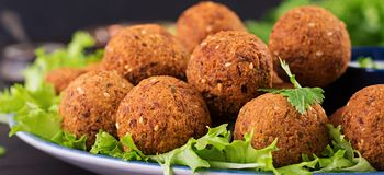 Falafel, hummus and pita. Middle eastern or arabic dishes on a dark background. Halal food. Banner royalty free stock photo