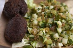 Falafel and israeli salad. Served for lunch royalty free stock photos