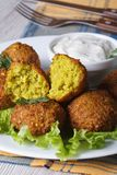 Falafel on lettuce leaves with tzatziki sauce, vertical Royalty Free Stock Image