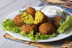 Falafel on lettuce with tzatziki sauce close-up horizontal Stock Photography