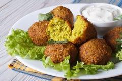 Falafel with lettuce and tzatziki sauce closeup horizontal Stock Images